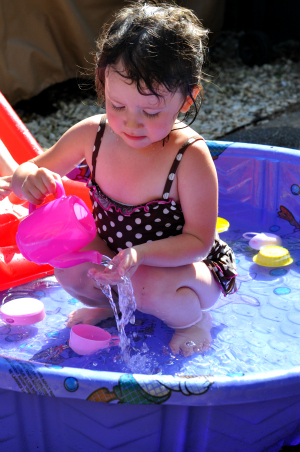 2 year old playing in baby pool