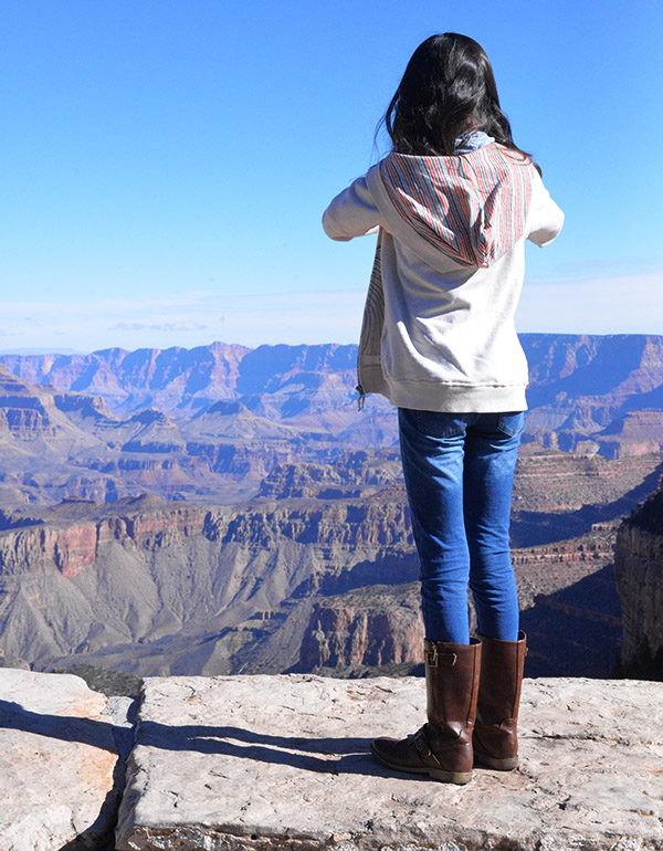 kid person taking picture of grand canyon