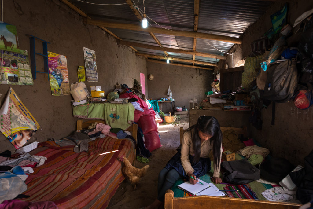 """See full story: Share# s150466-1 -- Sponsored child Yuridia Alejandra Mamani Pomo, 13, does her homework at her home in Soracachi, Bolivia.  """"I'm in seventh grade and my favorite subjects are mathematics and physics and music,"""" Yuridia says.  Her father Lucio Mamani Katari is a farmer in Soracachi ADP who is breaking ground in his community. Sponsorship enables his generosity and strengthens his commitment to his daughter's future.  Despite the area's high poverty rate, Lucio makes ends meet for his family of eight thanks to sponsorship-funded agriculture training.  In fact, he gives away his best produce to others. Lucio also began to see the value of education for his children through sponsorship.  He went against cultural norms and encouraged his 13-year-old daughter, Yuridia, a sponsored child, to pursue more school.  Since his community does not have a high school, Lucio sent Yuridia to live with an aunt in another city to continue her education.  This decision likely decreased the chance of early marriage for his daughter."""