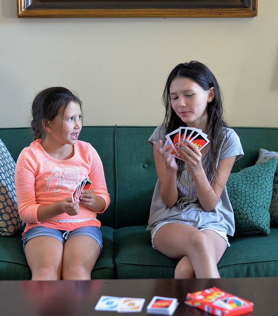 kids playing card game UNO