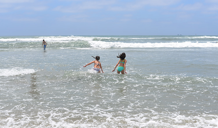 Kids playing at oceanside