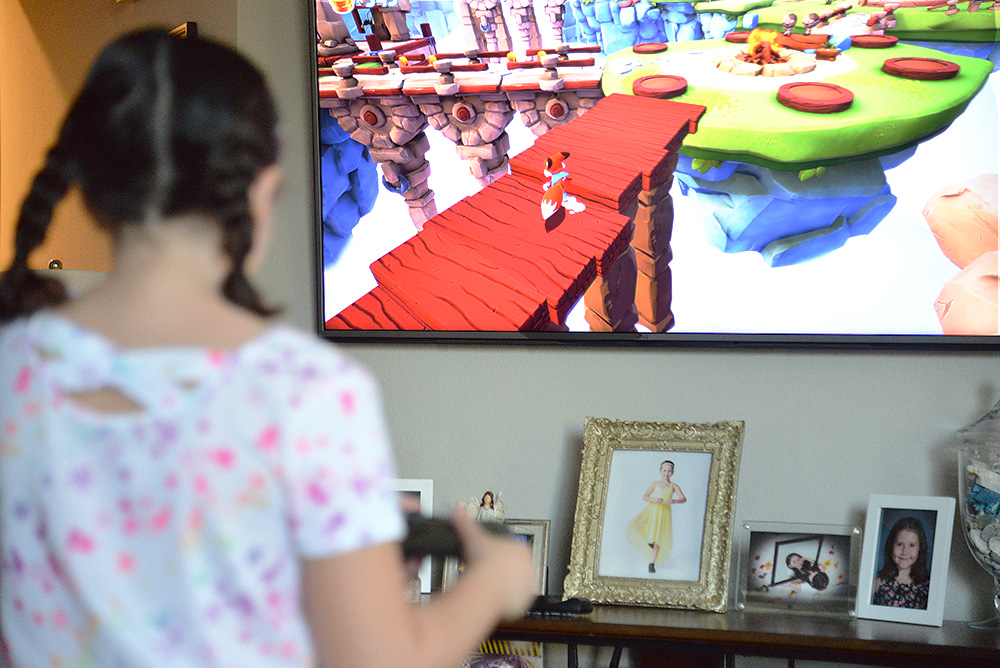 Super Luckys Tale Xbox kid playing on hdtv