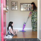 mom mopping kid putting on shoes